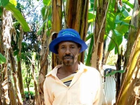 photo of John Muciri